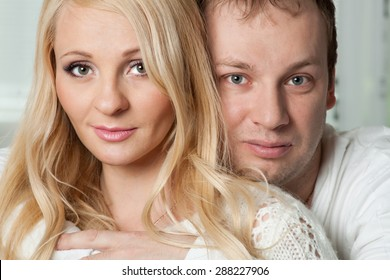 Closeup portrait of beautiful young couple. Attractive man and woman looking at camera.