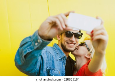 close-up portrait of a beautiful young couple in love bright blonde girl  with red 23ea30aa83bb