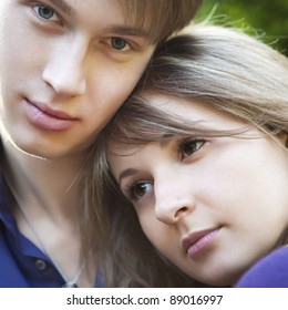Closeup portrait of a beautiful young couple outdoor