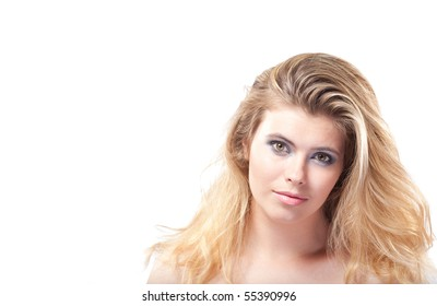 Closeup portrait of beautiful young elegant woman with large grey eyes and healthy blonde hair