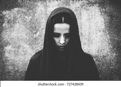 Close-up portrait of a beautiful, young goth girl. Attractive gothic woman.