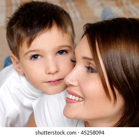 Close-up portrait of a beautiful young mother with her pretty little son