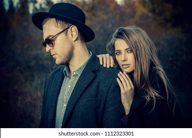 Close-up portrait of a beautiful young people walking in the autumn park. Autumn fashion.