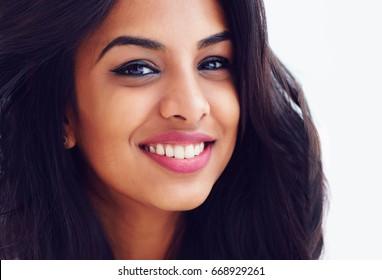 closeup portrait of beautiful young smiling indian woman