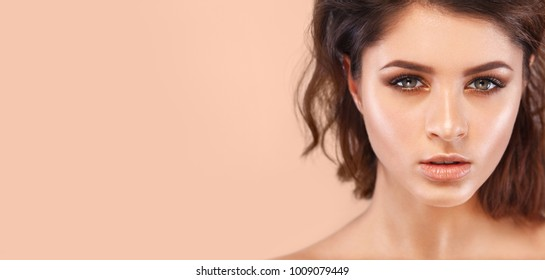 Closeup portrait of beautiful young woman with clean and fresh skin. Nude makeup. Concept for cosmetology ads with copy space, beauty magazine and spa.
