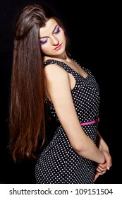 closeup portrait of a beautiful young woman with elegant long shiny hair from back , hairstyle , on a black background , healthy straight hair