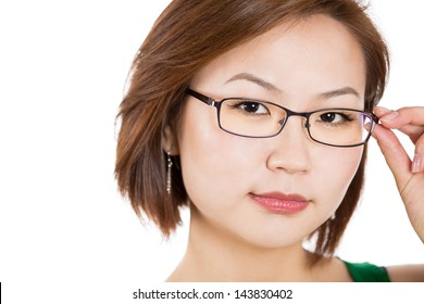 A close-up portrait of a beautiful young woman holding a glass frame, isolated on a white background