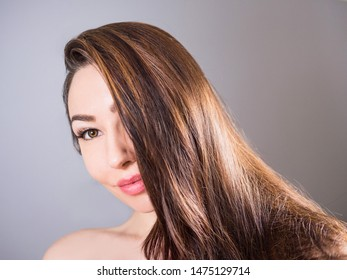 Close-up portrait of a beautiful young woman with a natural make-up