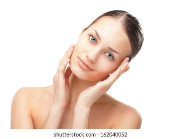 Close-up portrait of beautiful young woman with healthy clean skin touching her face isolated on white background
