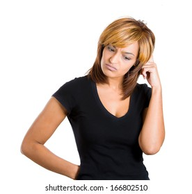 Closeup portrait of beautiful young woman thinking daydreaming deeply about something scratching head looking downwards, isolated on white background. Negative facial expression emotion feelings