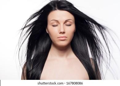 Closeup portrait of beautiful young woman with long hair. Fashion shot. Long hair concept. Studio portrait.
