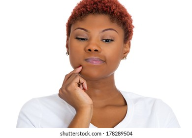 Closeup portrait of beautiful young woman, employee, thinking deeply about something, confused, deciding, plotting, looking downwards, isolated on white background. Negative emotion facial expressions