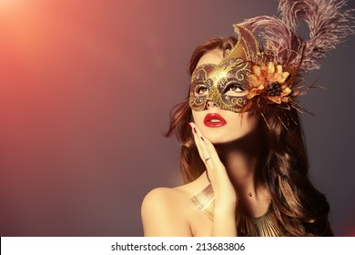 Close-up portrait of a beautiful young woman in a carnival mask. Vintage