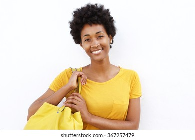 Closeup portrait of beautiful young woman carrying a bag against white background
