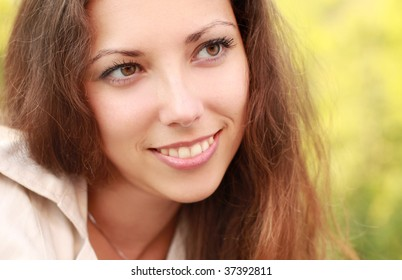 close-up portrait of beautiful young woman outdoors