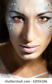 Closeup portrait of beautiful young woman with glamour makeup