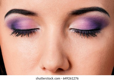 Close-up portrait of beautiful young woman or young girl with closed eyes - make-up