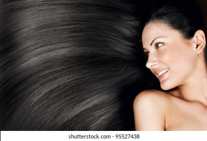 closeup portrait of a beautiful young woman with elegant long shiny hair , concept hairstyle