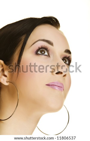 f27fd0494178 Close-up Portrait of a Beautiful Young Woman wearing big round earrings and  looking up
