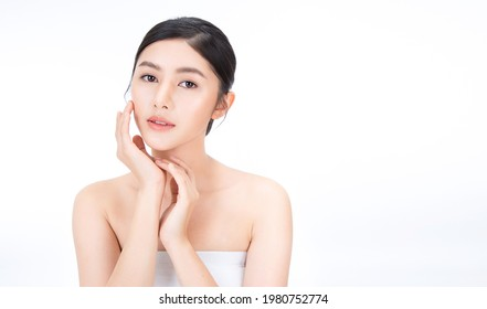 Closeup portrait of beauty asian woman with fair perfect healthy glow skin hand touching cheek isolated on white, young beautiful asia girl with pretty smile on face. Beauty korean spa skincare banner