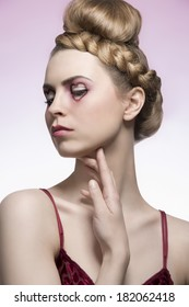 close-up portrait of beauty blonde woman with creative hair-style, red dress and valentines heart shaped make-up. Romantic concept