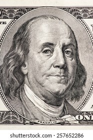 Close-up portrait of Benjamin Franklin in front of the one hundred US dollar bill