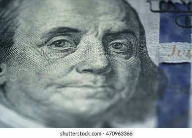 closeup portrait of Benjamin Franklin on new hundred dollar bill