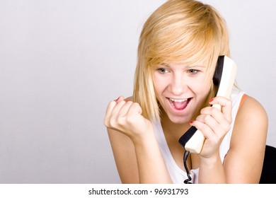 closeup portrait of blond woman with retro telephone