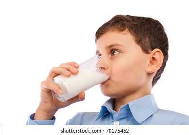 Closeup portrait of a boy drinking a glass of milk, isolated on white background