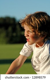close-up portrait of boy playing sport at park