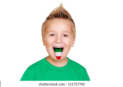 Closeup portrait of a boy showing tongue with italian flag on it