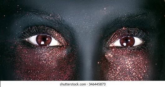 Closeup portrait of brown beautiful eyes of woman.