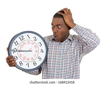 Closeup portrait of a business man, student, leader holding a clock very stressed, pressured by lack of time, running out of time, late for the meeting, isolated on a white background. Emotions