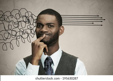Closeup portrait business man thinking about something, finger on lips looking for solution of problem isolated black background. Emotion facial expression reaction, situation perception body language