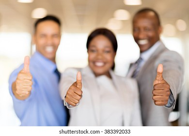 closeup portrait of business team giving thumbs up