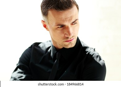 Closeup portrait of a businessman looking away isolated on a white background