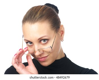 Closeup portrait of businesswoman looking over her spectacles