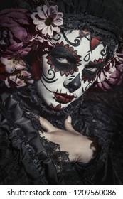 A close-up portrait of Calavera Catrina. Sugar skull makeup. Dia de los muertos. Day of The Dead. Halloween.