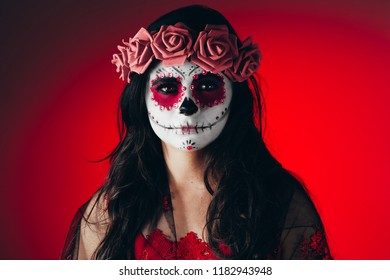 Closeup portrait of Calavera Catrina. Young woman with sugar skull makeup. Dia de los