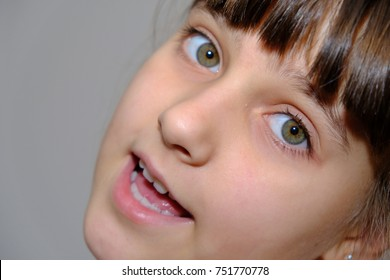 Closeup portrait of caucasian girl with open mouth and green eyes