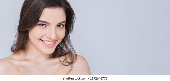 Closeup portrait caucasian woman with fair perfect healthy glow skin makeup, young beautiful girl with pretty smile on her face. Beauty clinic skincare spa surgery fashion concept panoramic banner