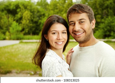 Close-up portrait of a charming couple smiling at the viewer