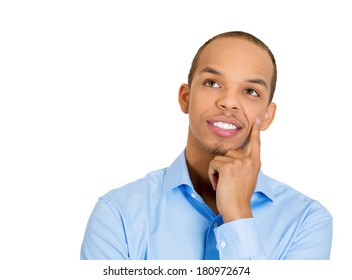 Closeup portrait of charming upbeat smiling joyful happy young man looking upwards, finger on cheek daydreaming, isolated on white background. Positive emotion facial expression feelings, attitude