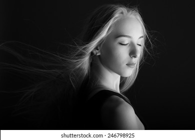 Closeup portrait of charming woman closed eyes