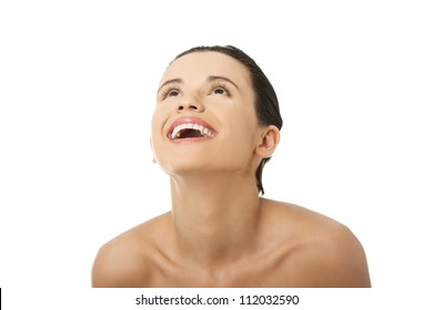 Close-up portrait of cheerful excited young adult girl - looking up