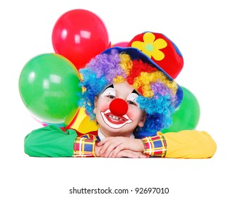 Closeup portrait of a child birthday clown holding the blank board