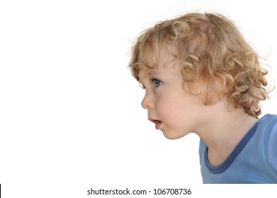 Close-Up portrait of a Child in profile looking curiously