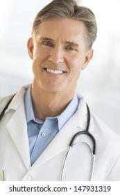 Closeup portrait of confident mature male doctor smiling