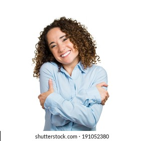 Closeup portrait, confident smiling woman, holding, hugging herself, isolated white background. Positive human emotion, facial expression, feeling, reaction, situation, attitude. Love yourself concept