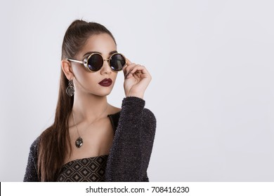 cc5a13d83f51 Closeup portrait confident successful beautiful attractive young woman  fashion girl posing holding sunglasses hand on glasses